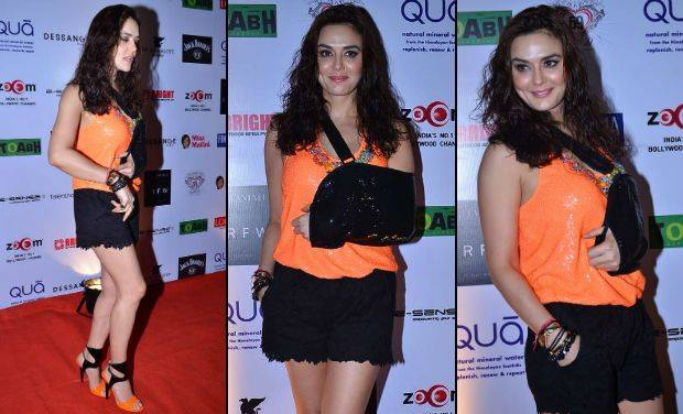 Preity Zinta hot photos, Preity Zinta in orange top, Preity Zinta in mini skirt, Preity Zinta masala photos, Preity Zinta hot thighs, Preity Zinta sexy legs, Preity Zinta spicy photos
