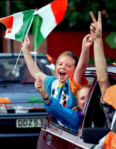 An Irish child celebrates the Northern Ireland Republic Of Ireland ceasefire in West Belfast