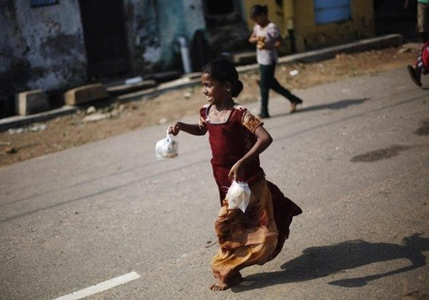This is a scene after the Phailin hit India. Look at the Joy on the girl's face after getting free meal for herself.