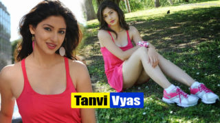 Tanvi Vyas Showing Her Sexy Legs in A Short Pink Mini Dress in Garden