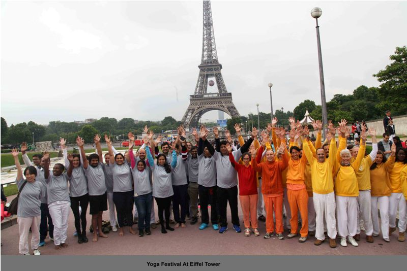 indians doing yoga at eiffel tower